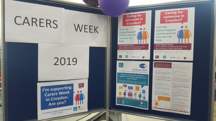 display board with Carers Week posters